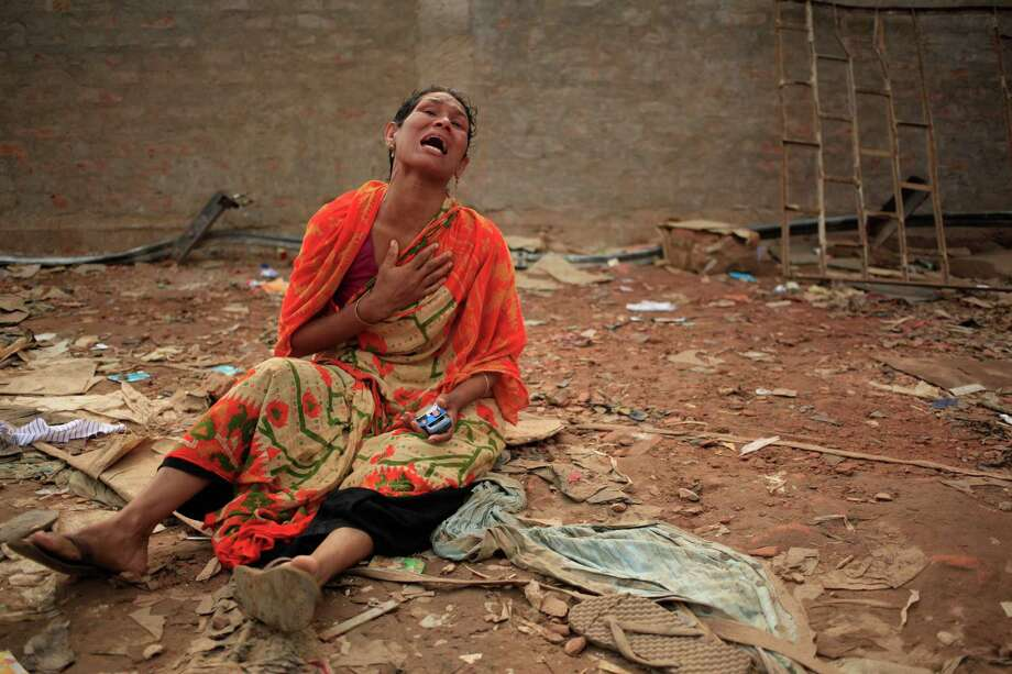 A woman cries out for her missing husband at the site of the garment factory building that collapsed Wednesday, in Savar, near Dhaka, Bangladesh, Saturday, April 27, 2013. Police in Bangladesh took five people into custody in connection with the collapse of a shoddily-constructed building this week, as rescue workers pulled 19 survivors out of the rubble on Saturday and vowed to continue as long as necessary to find others despite fading hopes. Photo: AP