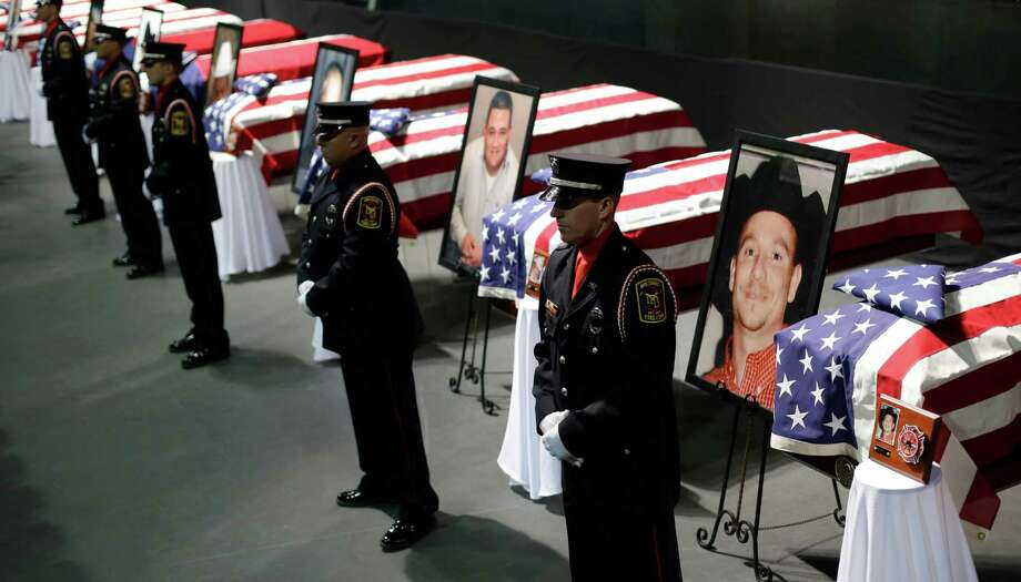 Honor guard stand in front of caskets prior to a memorial service for first responders who died in last week's fertilizer plant explosion in West, Texas, Thursday, April 25, 2013, in Waco, Texas.  President Barack Obama, U.S. Sen. John Cornyn and Texas Gov. Rick Perry are set to speak at Thursday's memorial at Baylor University's Ferrell Center in Waco. Firefighters and other first responders were among those killed when a fire at the plant erupted in an explosion last week. Hundreds of people were injured. Photo: AP