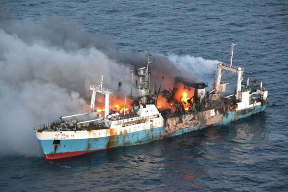In this picture taken on Friday, April 19, 2013, released by Chile's Air Force, Chinese factory fishing ship Kai Xin burnt just off the coast of Antarctica. Chile's navy said on Monday that Chinese factory fishing ship that caught fire last week off Antarctica has sunk without anyone on board, ruling out an oil spill because flames that burned for days likely consumed all of the vessel's fuel. Photo: AP