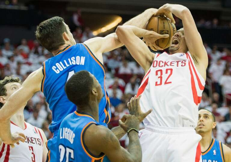 Thunder power forward Nick Collison blocks a shot by Rockets guard Francisco Garcia.