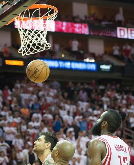 Rockets guards James Harden (13) and Carlos Delfino can only watch as a favorable bounce results in