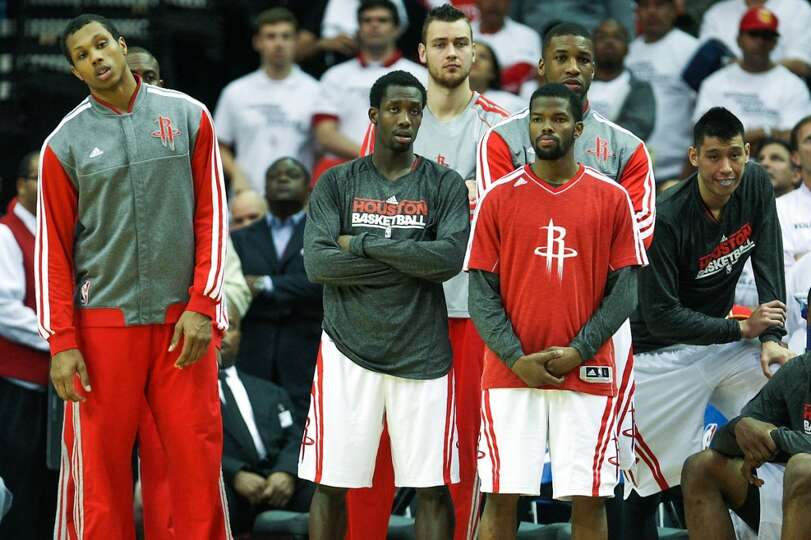 The Rockets bench looks on during the final moments.