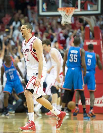 Rockets guard Francisco Garcia celebrates after hitting a 3-pointer to give the rockets a 99-97 lead