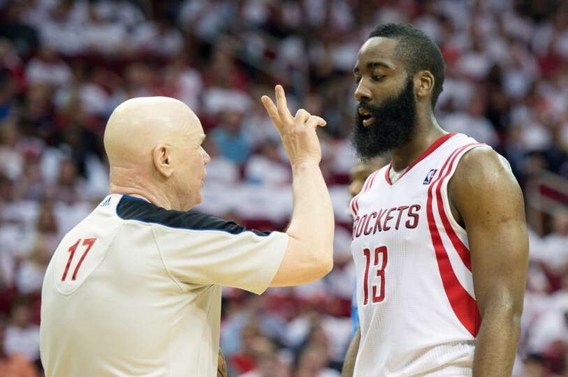 Referee Joe Crawford holds up two fingers to Rockets guard James Harden as he goes to the free throw