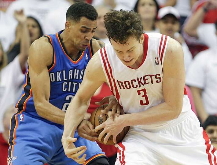 Thunder shooting guard Thabo Sefolosha left, and the Rockets center Omer Asik right, wrestle for the