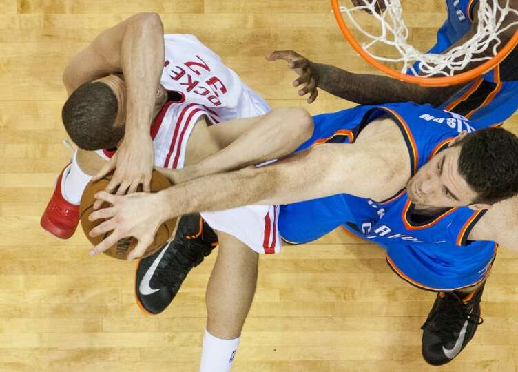 Rockets guard Francisco Garcia has the ball knocked away by Thunder power forward Nick Collison.