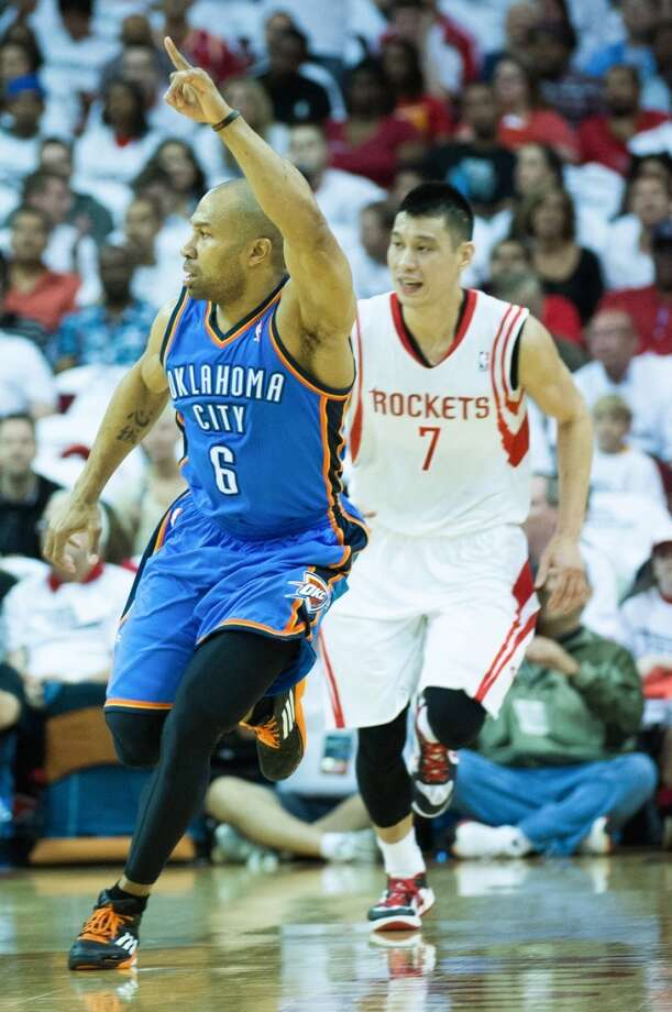 Thunder point guard Derek Fisher celebrates after a made shot during the first half. Photo: Smiley N. Pool, Houston Chronicle