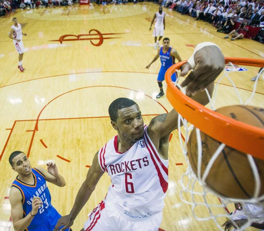 Rockets forward Terrence Jones dunks the ball past Thunder guard Kevin Martin. Photo: Smiley N. Pool, Houston Chronicle