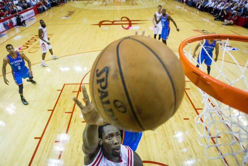 Rockets point guard Patrick Beverley  puts up a shot past Thunder power forward Nick Collison.