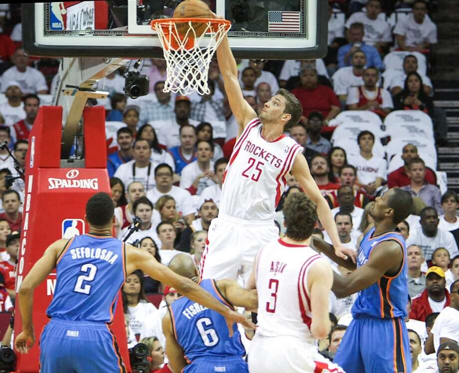 Rockets small forward Chandler Parsons dunks the ball during the first half. Photo: James Nielsen, Houston Chronicle