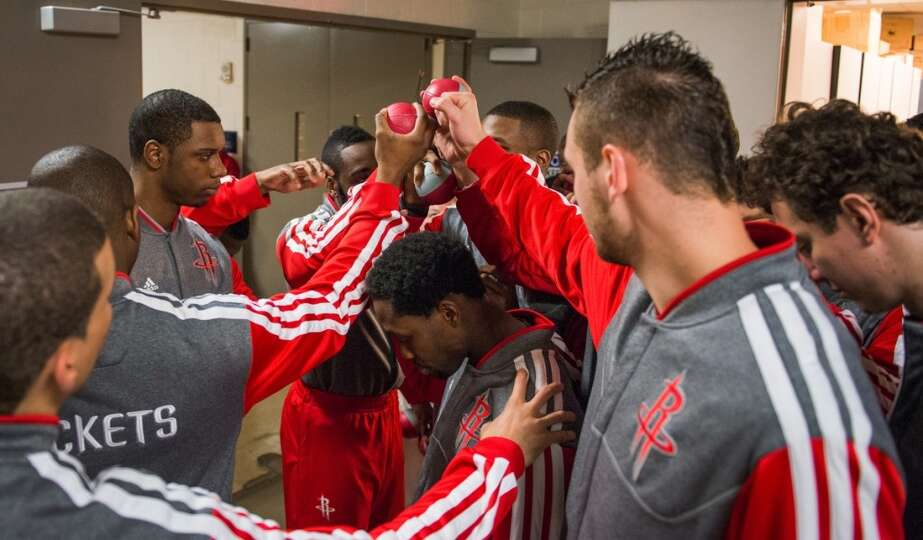 Rockets players huddle in the hallway outside the team locker room before the game.