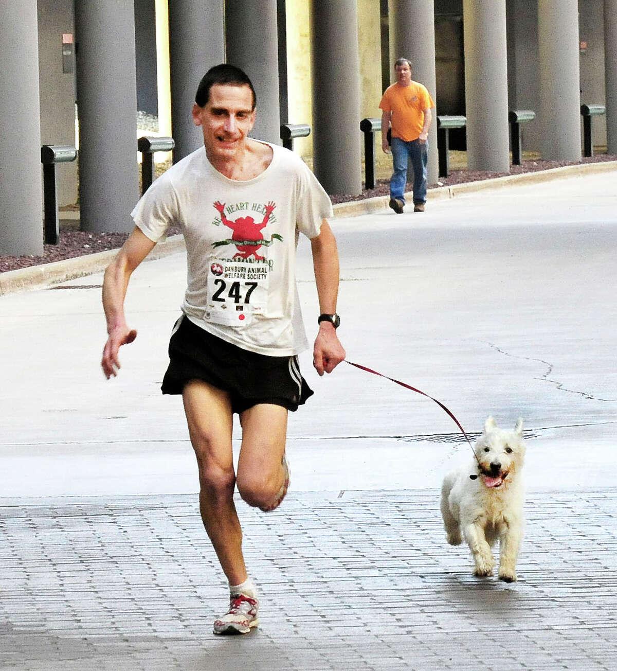 Eric Morse and his dog, Murdock, win the Danbury Animal Welfare Society's