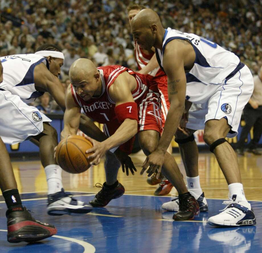 In Tracy McGrady and Yao Ming's first playoff series together in 2005, the Rockets stole the opening two games from the Dallas Mavericks on their home court during the first round of the playoffs. Photo: Karen Warren, Houston Chronicle