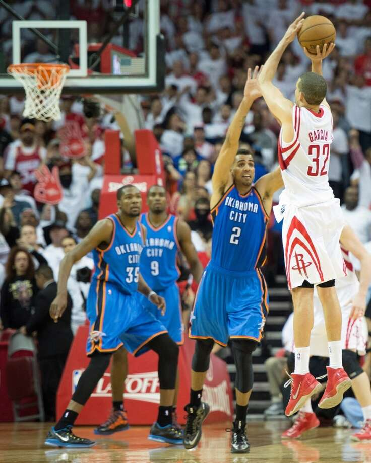Rockets guard Francisco Garcia (32) shoots a 3-pointer over Thunder guard Thabo Sefolosha (2) to give the rockets a 99-97 lead with 45 seconds left. Photo: Smiley N. Pool, Houston Chronicle