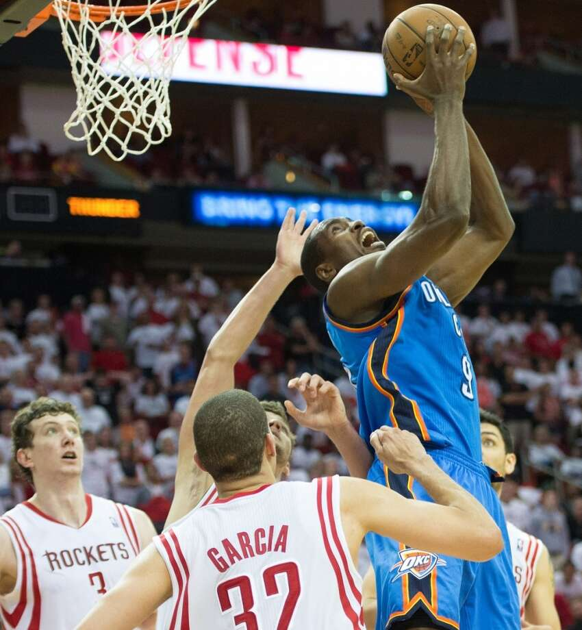 Thunder power forward Serge Ibaka makes a shot over his head during the second half. Photo: Smiley N. Pool, Houston Chronicle