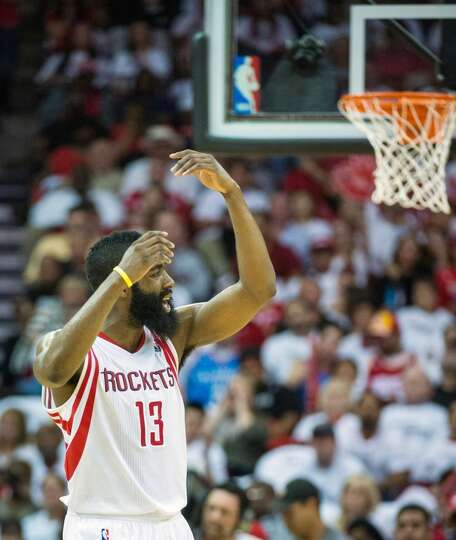 Rockets guard James Harden motions for more noise from the crowd.