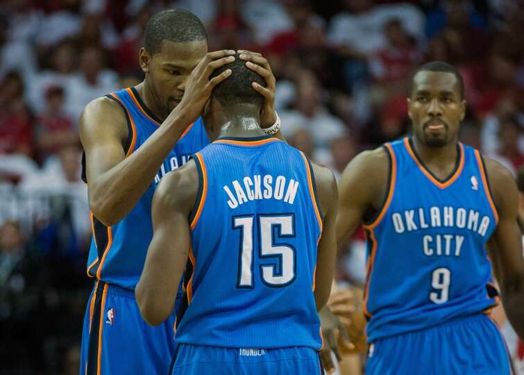 Thunder forward Kevin Durant huddles with point guard Reggie Jackson.
