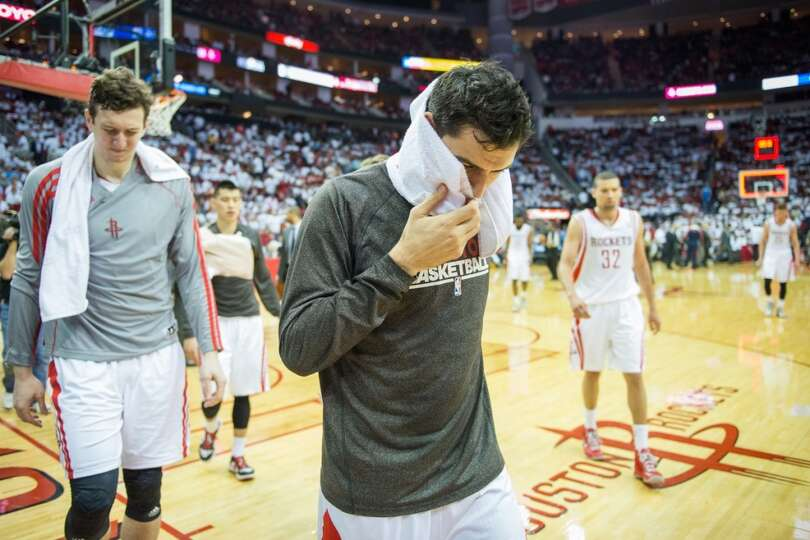 Carlos Delfino leaves the floor with Omer Asik, Jeremy Lin and Francisco Garcia with the Rockets dow