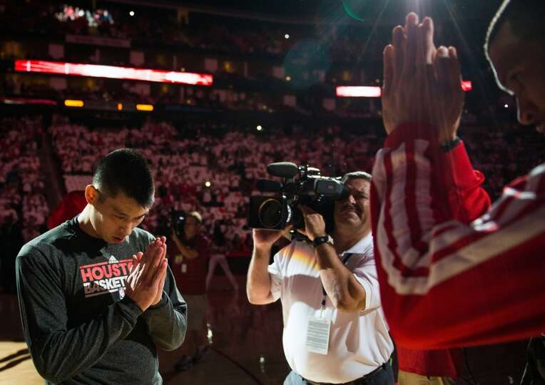 Rockets point guard Jeremy Lin bows to Francisco Garcia before Game 3.