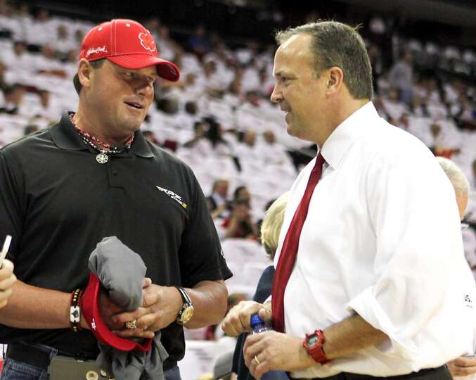 Former Houston Astros pitcher Roger Clemens left, and the Rockets CEO Tad Brown speak before the gam