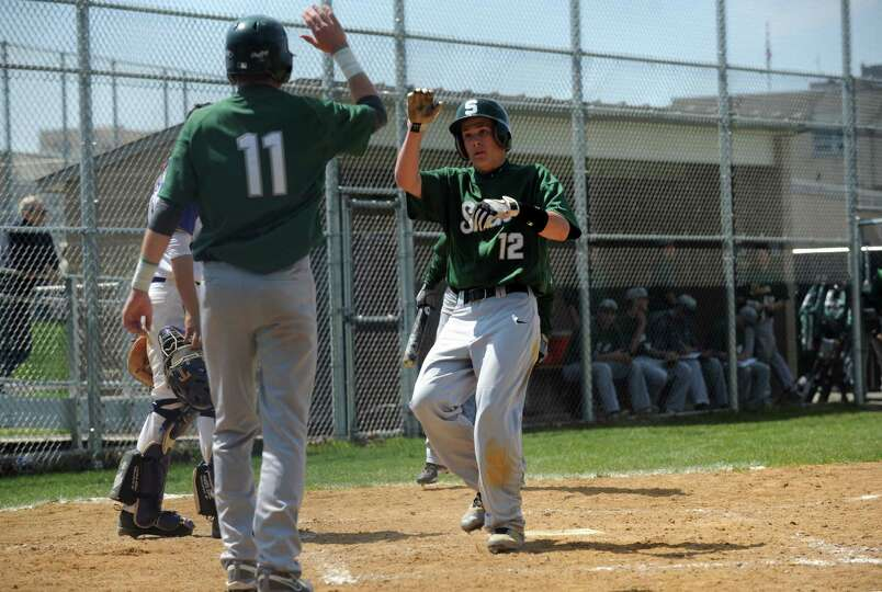 Shenendehowa's Kyle McAlonie gets met by teammate Brennan McCormack after scoring during their boy's