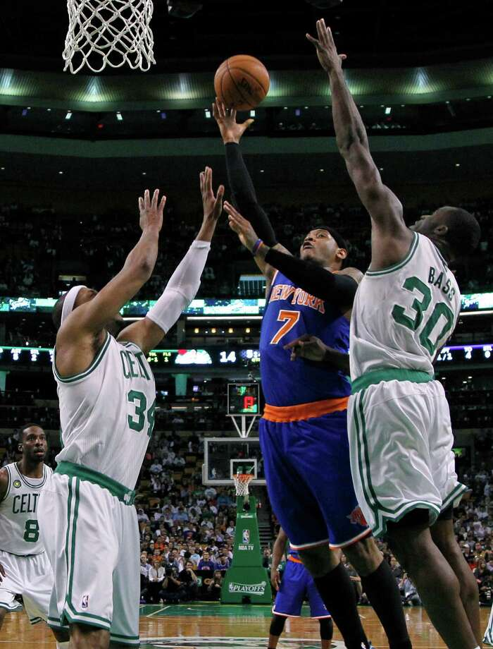 New York Knicks forward Carmelo Anthony (7) shoots against Boston Celtics forwards Paul Pierce (34) and Brandon Bass (30) during the first half in Game 4 of a first-round NBA basketball playoff series in Boston, Sunday, April 28, 2013. (AP Photo/Elise Amendola) Photo: Elise Amendola