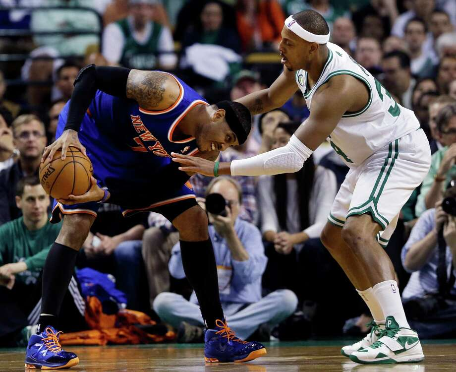 New York Knicks forward Carmelo Anthony, left, makes a move against the defense of Boston Celtics forward Paul Pierce during the first half in Game 4 of a first-round NBA basketball playoff series in Boston, Sunday, April 28, 2013. (AP Photo/Elise Amendola) Photo: Elise Amendola