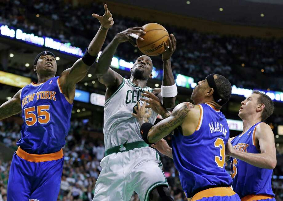 Boston Celtics center Kevin Garnett, second from left, pulls down an offensive rebound against New York Knicks forward Quentin Richardson (55), forward Kenyon Martin (3) and forward Steve Novak (16) during the first half in Game 4 of a first-round NBA basketball playoff series in Boston, Sunday, April 28, 2013. (AP Photo/Elise Amendola) Photo: Elise Amendola