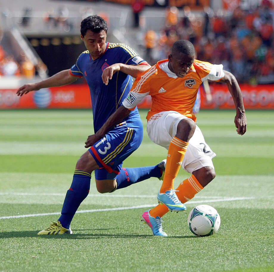 Colorado Rapids forward Kamani Hill, left, tries to contain Houston Dynamo midfielder Boniek Garcia during the first half of a MLS soccer game, Sunday, April 28, 2013, in BBVA Compass Stadium in Houston. Photo: Nick De La Torre, Chronicle / © 2013 Houston Chronicle