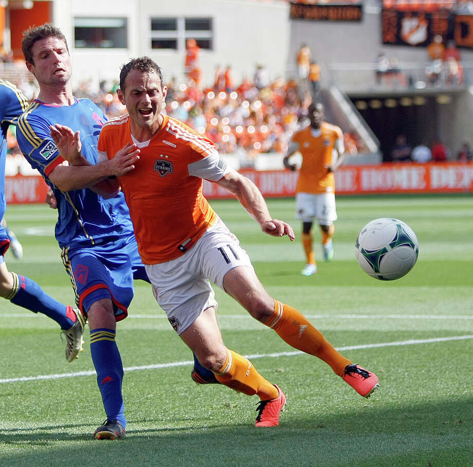Colorado Rapids defender Drew Moor, left, is called for a foul as he defends Houston Dynamo midfielder Brad Davis during the first half of a MLS soccer game, Sunday, April 28, 2013, in BBVA Compass Stadium in Houston. Photo: Nick De La Torre, Chronicle / © 2013 Houston Chronicle