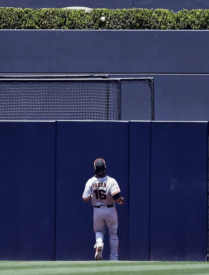 San Francisco Giants center fielder Angel Pagan runs out of room while chasing a home run ball hit by San Diego Padres' Chase Headley in the first inning of a baseball game in San Diego, Sunday, April 28, 2013. (AP photo/Lenny Ignelzi) Photo: Lenny Ignelzi, Associated Press