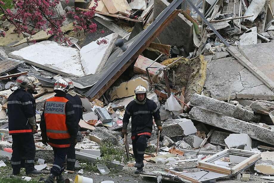 Firefighters check the rubble in the collapsed section of an apartment building after a suspected gas explosion in Reims. Photo: Francois Nascimbeni, AFP/Getty Images