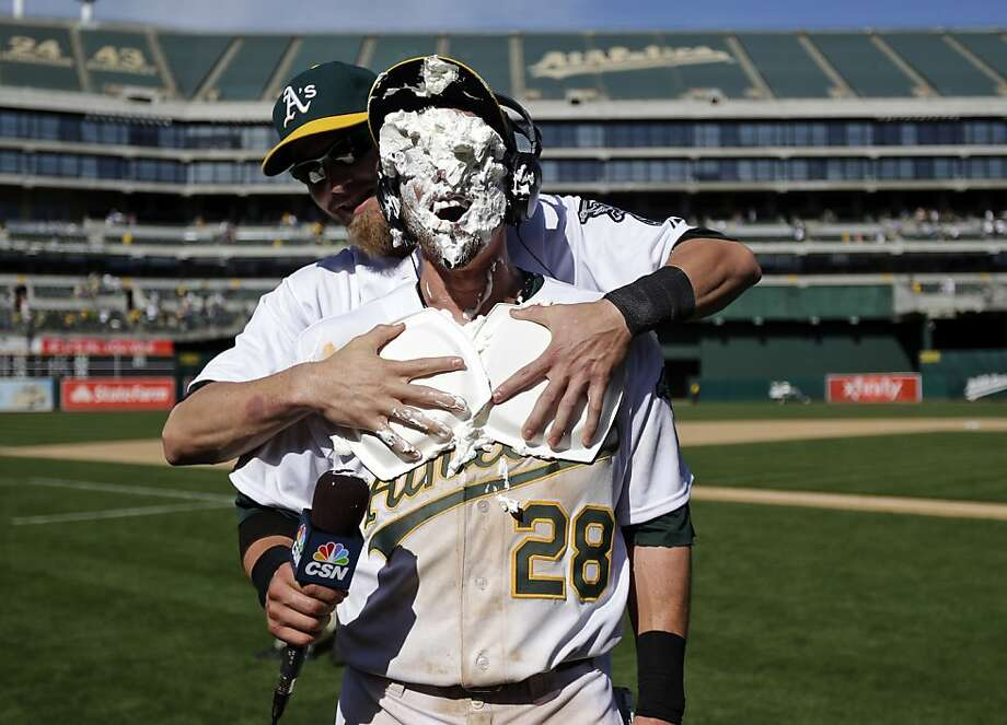 Oakland Athletics' Eric Sogard gets a shaving cream pie in the face from Josh Reddick, rear, after Sogard scored the winning run on a sacrifice bunt from Coco Crisp during 10th inning of a baseball game against the Baltimore Orioles, Sunday, April 28, 2013, in Oakland. Calif. Oakland won 9-8. (AP Photo/Marcio Jose Sanchez) Photo: Marcio Jose Sanchez, Associated Press