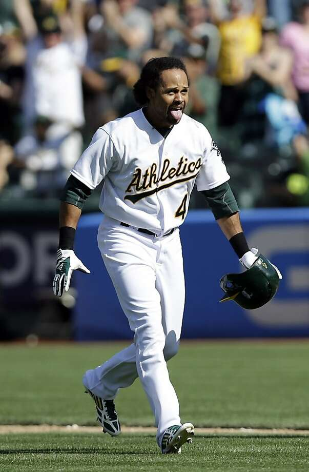 Oakland Athletics' Coco Crisp (4) reacts after his sacrifice bunt drove in the game-winning run against the Baltimore Orioles during the 10th inning of a baseball game on Sunday, April 28, 2013 in Oakland. Calif. The Athletics' Eric Sogard scored on Crisp's bunt after a throwing error to third base from Baltimore Orioles' Manny Machado. Oakland won 9-8. (AP Photo/Marcio Jose Sanchez) Photo: Marcio Jose Sanchez, Associated Press