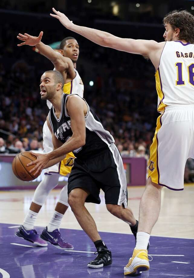 San Antonio Spurs' Tony Parker drivers under Los Angeles Lakers' Darius Morris and Los Angeles Lakers' Pau Gasol during first half action of  game 4 in the first round of the NBA Playoffs Sunday April 28, 2013 at the Staples Center in Los Angeles, CA.