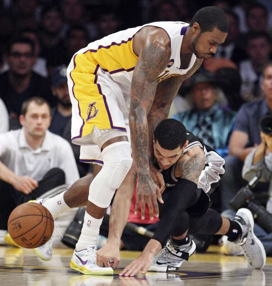 Los Angeles Lakers' Earl Clark and San Antonio Spurs' Danny Green chase after a loose ball during first half action of game 4 in the first round of the NBA Playoffs Sunday April 28, 2013 at the Staples Center in Los Angeles, CA.