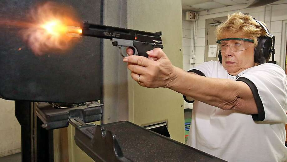 Shirley Hedge, a member of Pennbrook Pistoleros gun club, takes target practice on April 10, 2013, at The Gun Shop & Gun Range in Leesburg, Florida. Hedge, known as 'Shotgun Shirley' in the gun club is using a Smith & Wesson, 22-caliber handgun. (Red Huber/Orlando Sentinel/MCT) Photo: Red Huber, McClatchy-Tribune News Service