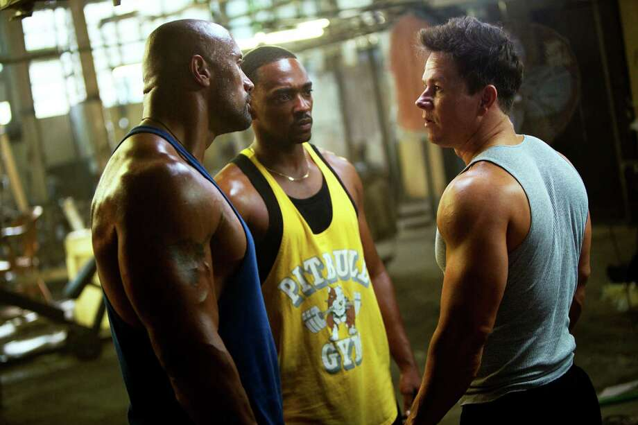 """This film image released by Paramount Pictures shows, from left, Dwayne Johnson, Anthony Mackie and Mark Wahlberg in a scene from """"Pain and Gain."""" (AP Photo/Paramount Pictures, Jaime Trueblood) Photo: Jaimie Trueblood"""
