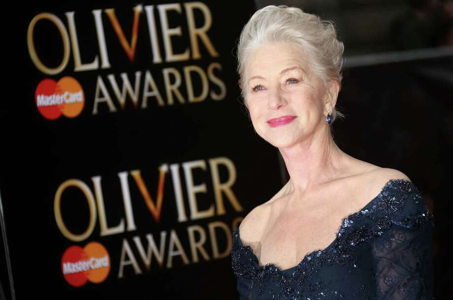 Helen Mirren poses on arrival at the Olivier Awards 2013 at the Royal opera House in London on Sunday, April 28, 2013. (Photo by Joel Ryan/Invision/AP) Photo: Joel Ryan