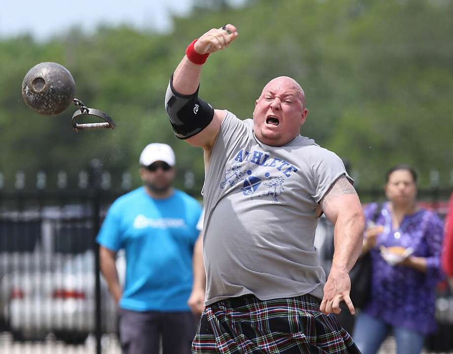 Chad Crawford of Houston competes in the stone toss in the Men's B&C Class at the Houston Celtic Festival and Highland Games at the Houston Farm and Ranch Club in Houston, Texas, Sunday, April 28, 2013. (AP Photo/The Courier, Alan Warren) Photo: Alan Warren, Associated Press