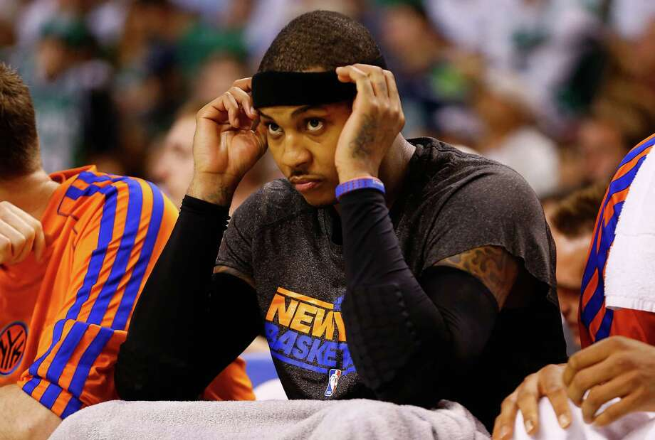 BOSTON, MA - APRIL 28: Carmelo Anthony #7 of the New York Knicks sits on the bench in the third quarter against the Boston Celtics during Game Four of the Eastern Conference Quarterfinals of the 2013 NBA Playoffs on April 28, 2013 at TD Garden in Boston, Massachusetts. NOTE TO USER: User expressly acknowledges and agrees that, by downloading and or using this photograph, User is consenting to the terms and conditions of the Getty Images License Agreement. (Photo by Jared Wickerham/Getty Images) Photo: Jared Wickerham, Getty Images / 2013 Getty Images