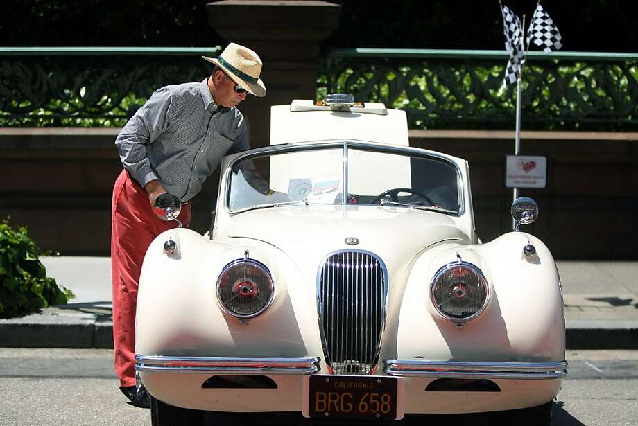 Peter Stoneberg shines his 1954 Jaguar XK120 DHC outside the Fairmont San Francisco during the California Mille. Photo: Jessica Olthof, The Chronicle