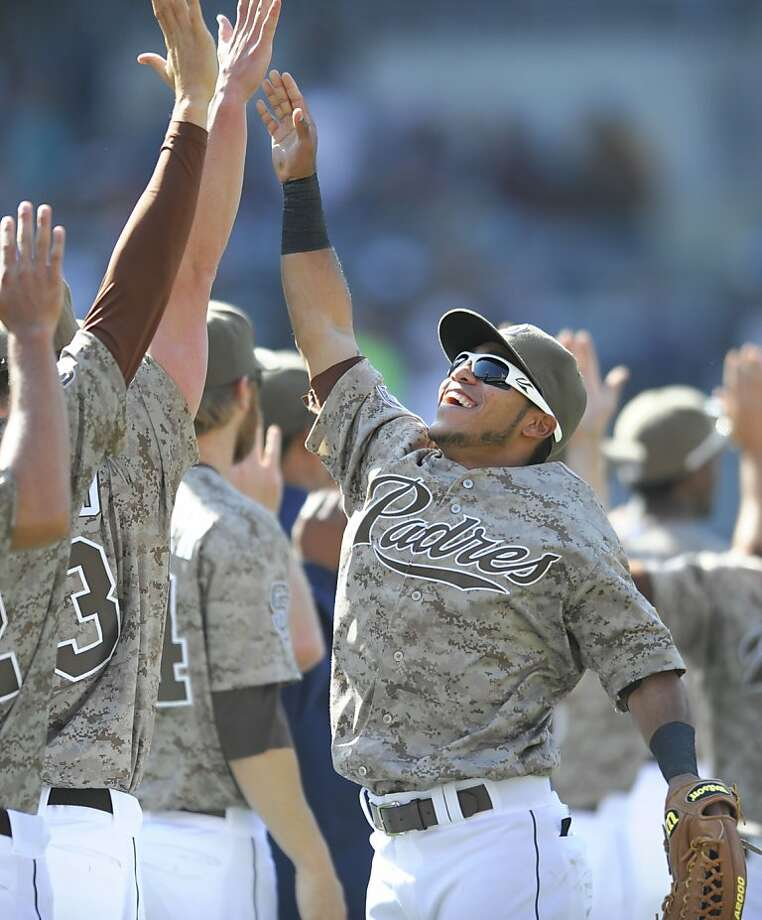 SAN DIEGO, CA - APRIL 28:  Alexi Amarista #5 of the San Diego Padres jumps to high-five teammates after the Padres beat the San Francisco Giants 6-4 in a baseball game at Petco Park on April 28, 2013 in San Diego, California.  (Photo by Denis Poroy/Getty Images) Photo: Denis Poroy, Getty Images