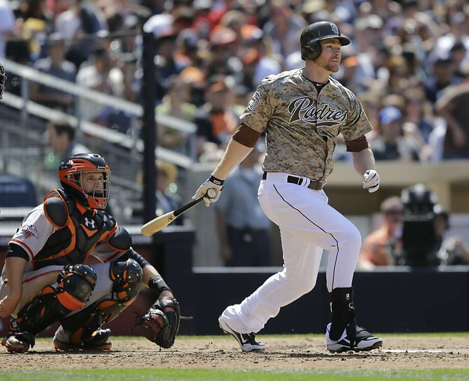 San Diego Padres' Chase Headley strokes one of his three extra base hits against the San Francisco Giants in a baseball game in San Diego, Sunday, April 28, 2013. (AP photo/Lenny Ignelzi) Photo: Lenny Ignelzi, Associated Press