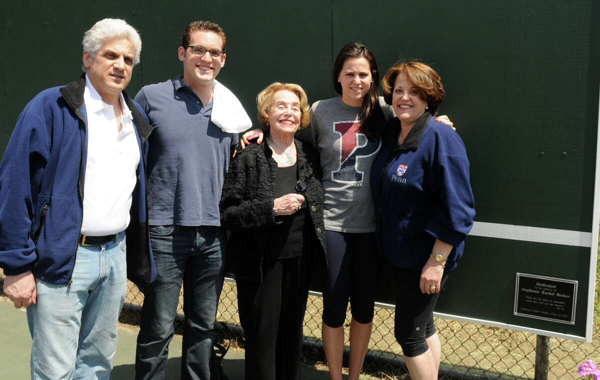 Stephanie Becker's family, from left, her father Jonathan, brother Michael, grandmother Joan Rubenstein, sister Julie and mother Patti, gather at Westhill High School next to a plaque in her honor on the new backboard at the tennis courts in Stamford Conn., April 28, 2013. Becker was an academic and athletic standout during her years at Westhill, she committed suicide last year.