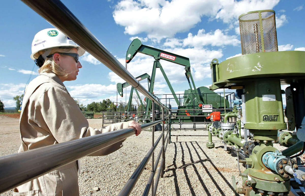 BP Florida manager Kourtney Hardwick eyes a Colorado methane gas well in 2009. The EPA has lowered its estimates of methane releases during production.