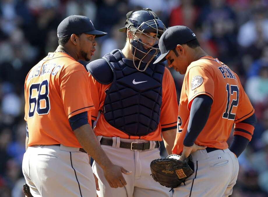 April 28: Red Sox 8, Astros 4 Astros relief pitcher Jose Cisnero, catcher Jason Castro, center, and first baseman Carlos Pena meet on the mound after Cisnero was called for a balk during the seventh inning Photo: Mary Schwalm, Associated Press