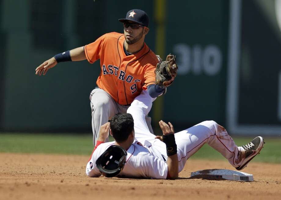 Marwin Gonzalez of the Astros tags out Jacoby Ellsbury of the Red Sox.