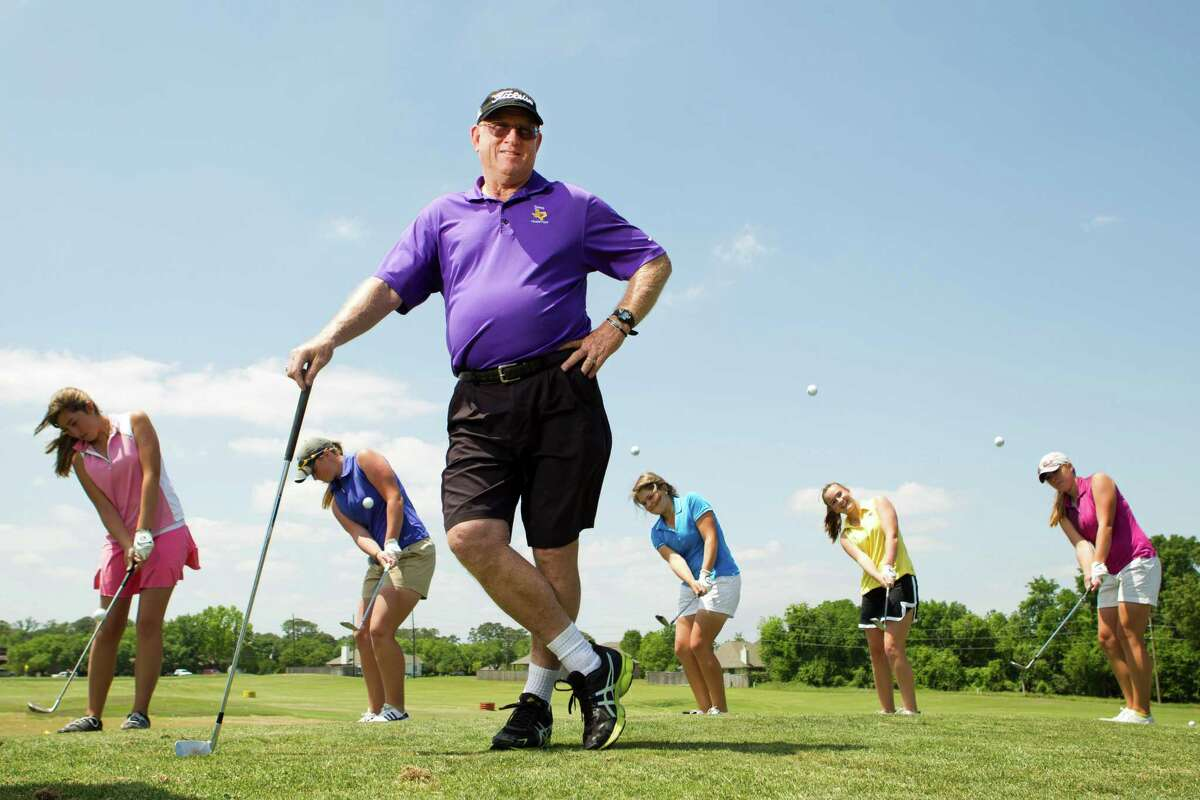 Montgomery High School golf coach Rusty Herridge poses for a portrait, with his golfers, from left, Jessica Ritchie, Kendall Wisenbaker, Kallie Gonzales, Ellen Hammond, and Kaitlin Fox, before practice at the Walden Golf School Monday, April 22, 2013, in Montgomery. Herridge is trying this season to lead the Montgomery Lady Bears to their 13th state championship. ( Brett Coomer / Houston Chronicle )