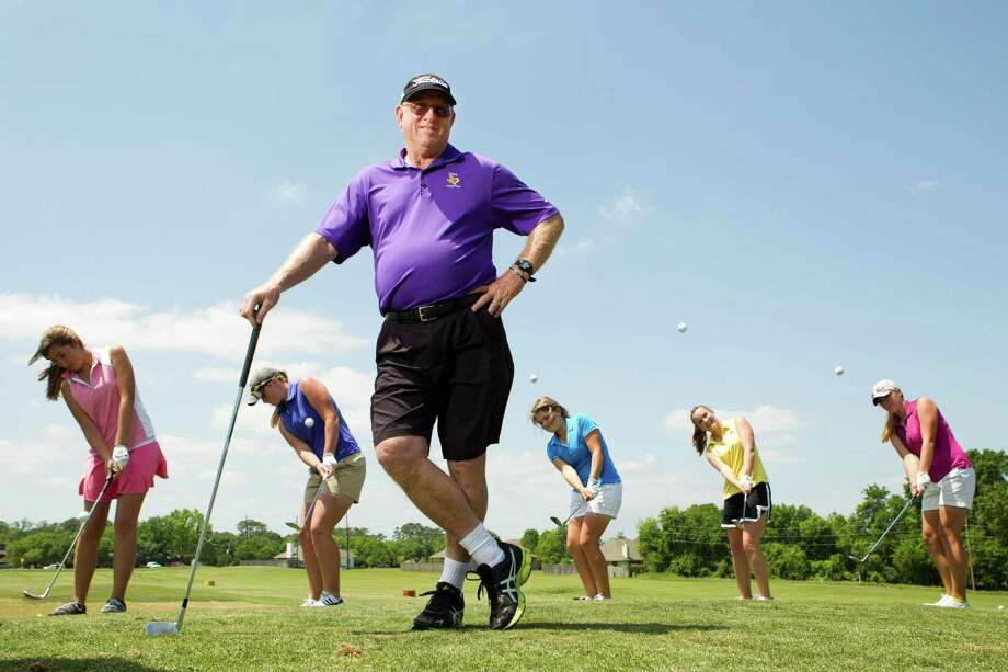 Montgomery High School golf coach Rusty Herridge poses for a portrait, with his golfers, from left, Jessica Ritchie, Kendall Wisenbaker, Kallie Gonzales, Ellen Hammond, and Kaitlin Fox, before practice at the Walden Golf School Monday, April 22, 2013, in Montgomery. Herridge is trying this season to lead the Montgomery Lady Bears to their 13th state championship. ( Brett Coomer / Houston Chronicle ) Photo: Brett Coomer, Staff / © 2013 Houston Chronicle